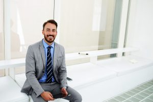 young businessman smiling employee engagement realized worth